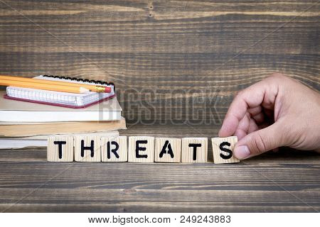 Threats. Wooden Letters On The Office Desk, Informative And Communication Background