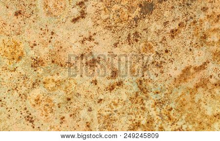 Rusted Painted Metal Wall. Rusty Metal Background With Streaks Of Rust. Rust Stains. The Metal Surfa