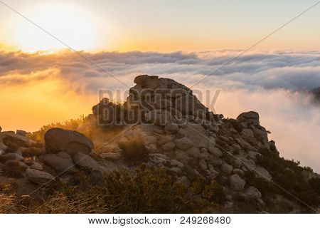 Above sunrise clouds at Rocky Peak Park above the San Fernando Valley in Los Angeles, California.
