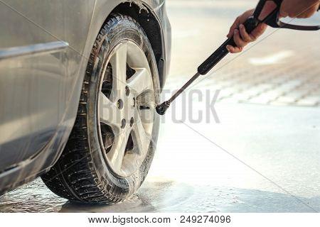 Car Wheel Washing. Car Cleaning With Water Jet. Car Rim Wash Close Up