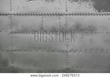 Old Silver Metal Surface Of The Aircraft Fuselage With Rivets