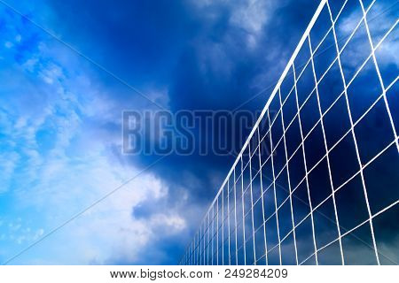 A Beach Volleyball Net On The Background Of Blue Sky With Clouds