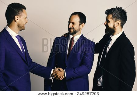 Ceos Shake Hands On Light Grey Background. Business Agreement And Compromise Concept. Businessmen We