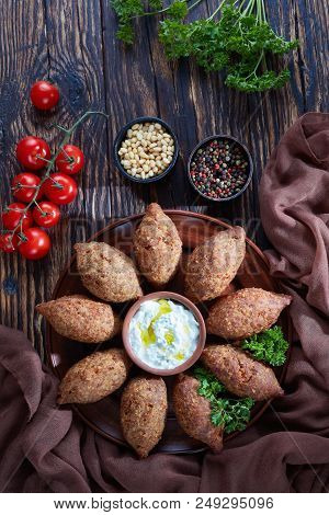 Deep Fried Kibbeh Of Ground Beef Meat Mixed With Bulgur, Fried Minced Meat With Pine Nuts, Spices, G