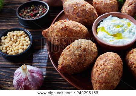 Close-up Of Deep Fried Kibbeh Of Ground Beef Meat Mixed With Bulgur, Stuffed With Fried Minced Meat