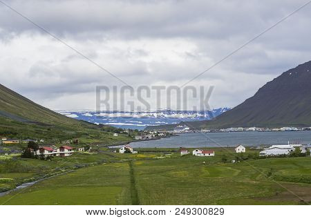 Beautiful View On Isafjordur City, Capital Of West Fjords Of Iceland In Summer With Red Houses, Harb