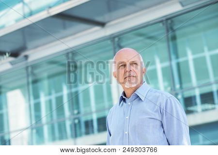 Low Angle View Of Business Man Looking Off