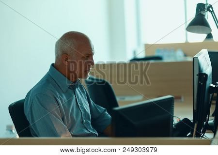 Profile View Of Senrio Man Working At Computer.