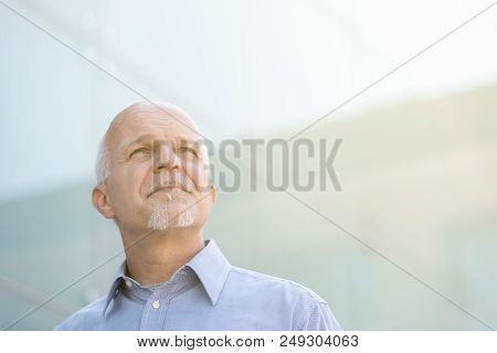 Man Looking Up And Observing Something