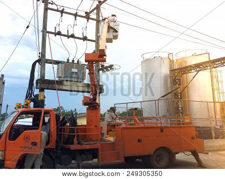 Chiang Mai, Thailand 31/3/2018 Electrical Power Repairs On Electric Pillar Using The Trampoline Elec