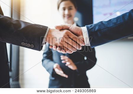 Finishing Up A Meeting, Business Handshake After Discussing Good Deal Of Trading To Sign Agreement A