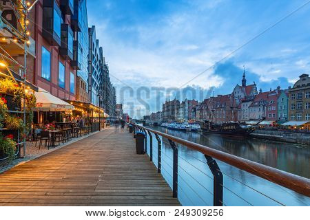 Gdansk, Poland - July 12, 2018: Architecture of the old town in Gdansk at Motlawa river, Poland. Gdansk is the historical capital of Polish Pomerania with medieval old town architecture.
