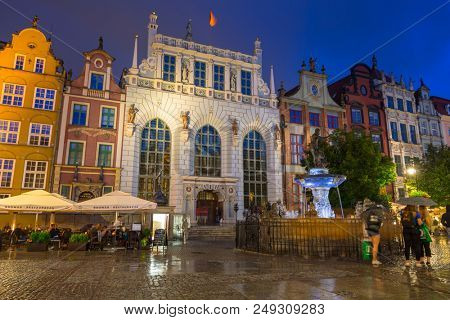 Gdansk, Poland - July 12, 2018: Architecture of Artus Court in Gdansk at night, Poland. Gdansk is the historical capital of Polish Pomerania with medieval old town architecture.