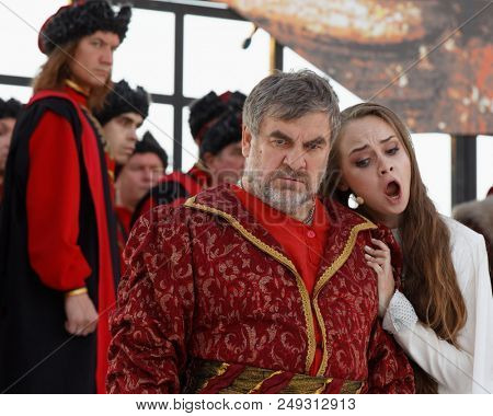 ST. PETERSBURG, RUSSIA - JULY 12, 2018: Alexander Nikitin as Gryaznoy (center) and Olga Cheremnykh as Marfa in the opera The Thar's Bride outdoors during the festival All Together Opera