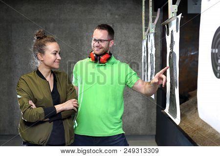Shooting Range. A Woman And A Man At The Shooting Range