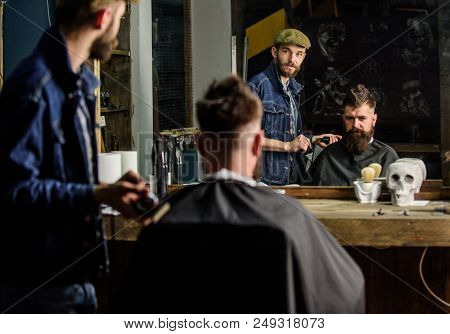 Barber Preparing Hair Clipper For Bearded Man, Barbershop Background. Hipster Lifestyle Concept. Hip