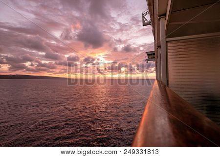 Cruise ship sailing towards a magnificent sunset poster