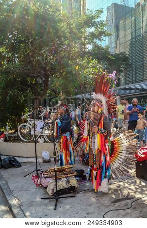 Peruvian Band Playing And Singing At The Paulista Avenue