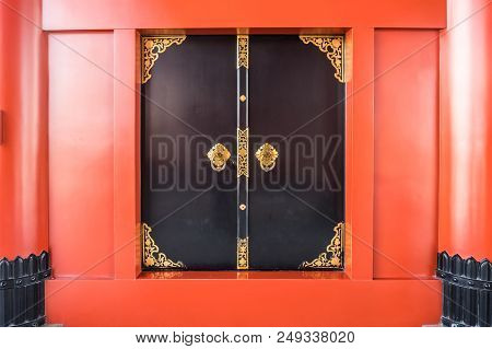 Black Window With Traditional Golden Pattern And Red Wall At Sensoji Temple Asakusa Tokyo Japan