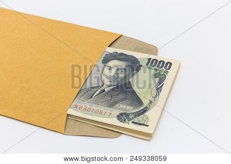 Japanese Banknote 1,000 Yen In Brown Envelope For Give And Business Success And Shopping. Business C
