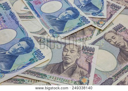 Japanese 1,000 And 10,000 Yen Banknotes Business And Finance Concept Background