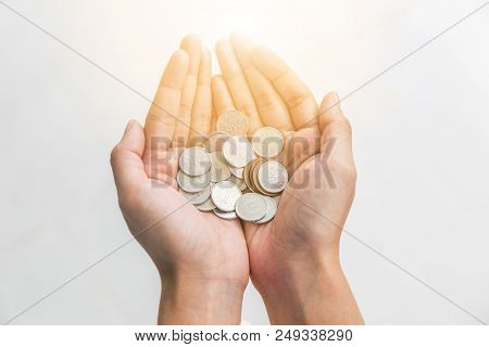 Japanese Yen Coins In Woman Hand On White Background