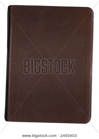 An old leather bound book on a white background poster