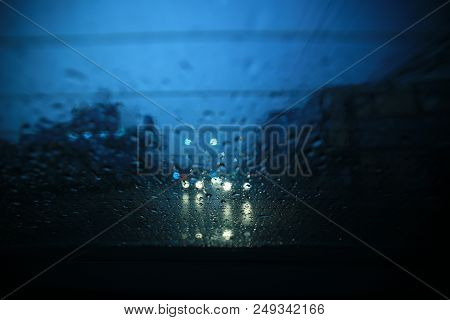 Raining In The Street. Dark Cloud And Heavy Rain. Windshield Of A Car Soak With Water Droplet. Selec