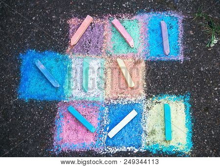 Colored Chalk On A Sidewalk  Background, Top View
