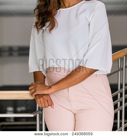 Cropped head Business Woman in corporate attire in an office environment poster