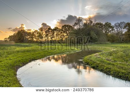 Sunset Over Meandering Creek In Small River Valley In Drenthe, Netherlands