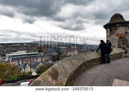 Edinburgh, Scotland - April 2018: Tourists Overlooking Scenic View Of Edinburgh City From The Esplan