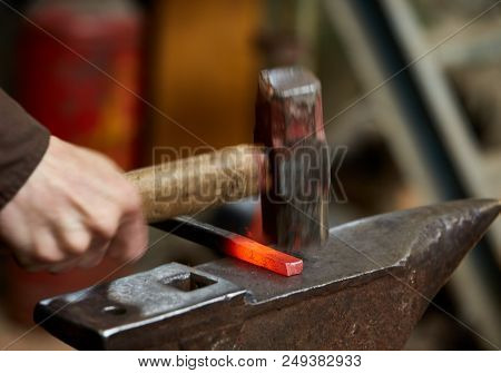 Close-up Of A Blacksmith's Hands Manipulating A Metal Piece Above His Forge, Selective Focus.