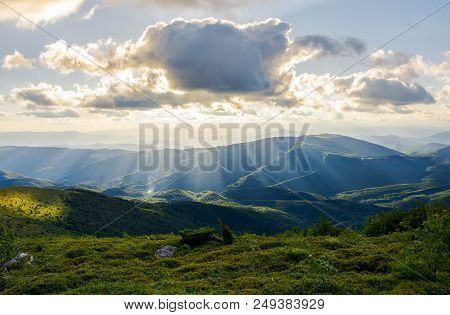 Beautiful Mountainous Summer Landscape. Sun Ray Fall On Hillside. Sun Behind The Cloud. Lovely Scene