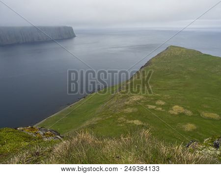 Scenic View On Edge Of The Cliff From Top Of Steep King And Queen Hornbjarg Cliffs In West Fjords, R