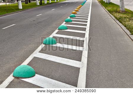 An Empty Bicycle Path, Bikeway Or Bicycle Lane Separated By Road Markings And Restrictive Hemisphere