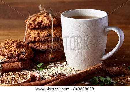 White Porcelain Mug Of Black Tea Or Earl Grey And Pile Of Sweet Cookies On Flat Piece Of Wood Over R