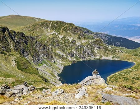 Rock Balancing, Rock Stacking In Front Of The Kidney Lake, Babreka Lake - One Of The Seven Rila Lake
