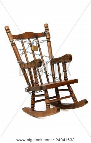 Old Wooden Rocking Chair Captured With Chain And Padlock On White