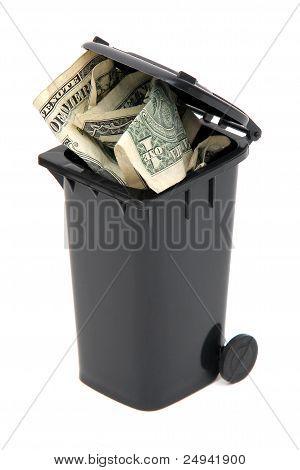 Dollar Notes In Black Rubbish Bin On White