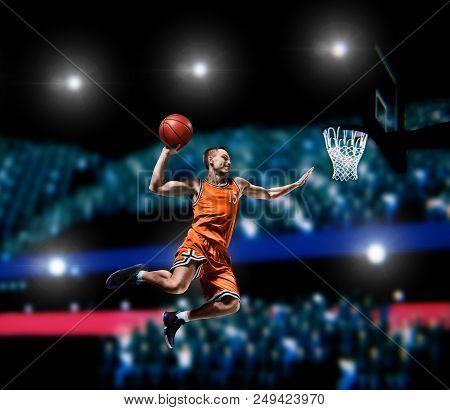 Basketball Player Making Slam Dunk On Basketball Arena Lights Background