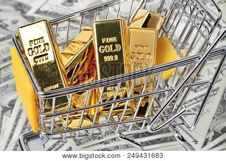 Gold Bars 1 Kg, In Shopping  Trolley With Yellow Mark For Supermarket And 2 Gold Bars On Bank Note.