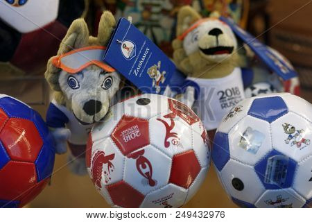 ST. PETERSBURG, RUSSIA - JULY 13, 2018: Official souvenirs of FIFA World Cup Russia 2018 on a show window of souvenir shop. Zabivaka wolf is the official mascot of this World Cup