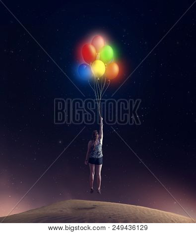 Young Girl Taking Off The Ground To Sky Holding Colorful Balloons.
