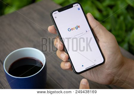 Koh Samui, Thailand - March 26, 2018: Man Holding Iphone X With Social Networking Service Google On