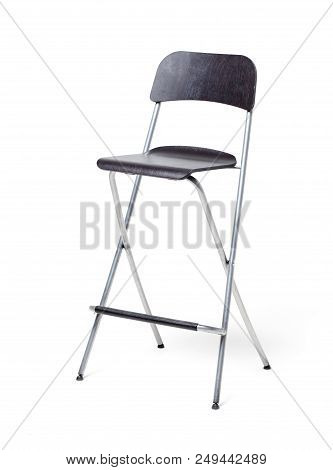A Chair On A White Background. Isolated. Black Chair With A High And Thin Legs Metallic Color.