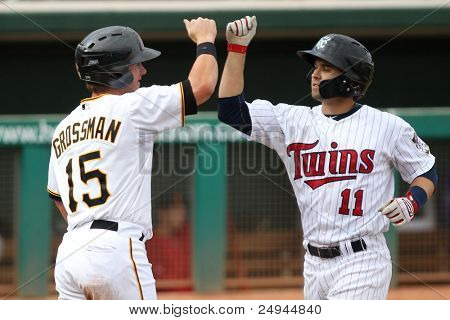 MESA, AZ - NOVEMBER 4: Mesa Solar Sox outfielder Robbie Grossman and infielder Brian Dozier (11) celebrate in a game against the Salt River Rafters at Hohokam Park on November 4, 2011 in Mesa, AZ.