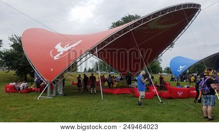 Giant Red Tent At Pokemon Go Fest, People Walking Around Catching Pokemon On Their Mobile Cellphones