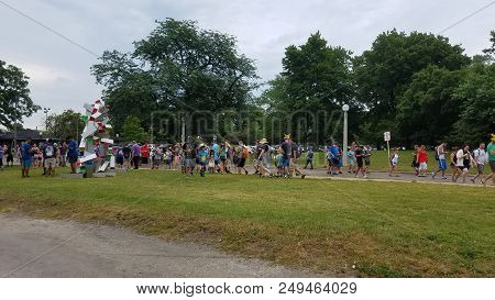 Pokemon Go Fest, People Walking Around Catching Pokemon On Their Mobile Cellphones In Lincoln Park,