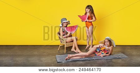 Group Little Girl In Swimwear, Summer Concept. Beautiful Funny Three Children Resting On Vacation. S